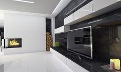 Nadčasový interier rodinného domu s minimalistickým poňatím prvkov mobiliáru, čistou líniou kompozičných tvarov a kontrastným materiálovým riešením tvoriacim vyrovnanú harmóniu.
