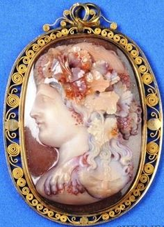 Antique Carnelian Cameo Pendant, Depicting The Young Bacchus, With Crown Of Grape Clusters, Wearing A Panther Skin, In A Later Gold Filigree Frame     c.1801-1908  -  Prices4Antiques