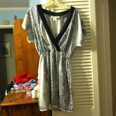 Dress NWOT *REDUCED* 100% polyester dress. Overlapping v-neck. Elastic band around waist. Built in slip. White with black polka dot pattern. Short sleeves Dresses