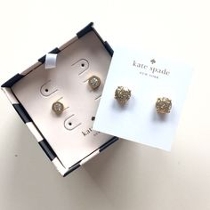 [final price] 2 pairs kate spade earrings 2 pairs of kate spade earrings! Gold tone with faux diamond studs are NWT & never worn. We're part of a set that I never wore, will include original kate spade box that they came in. Other pair are round studs with gold & silver sparkles. These have been worn once & throughly cleaned. In like new condition. Price is firm unless bundled. No trades, sell through Poshmark only, thank you! kate spade Jewelry Earrings