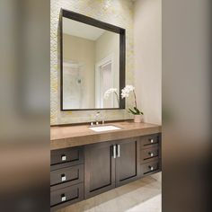 We\'re Loving This Renaissance Tile From Nicola Colclough.strong! It Gave This Modern Floating Vanity A Fun Sleek Look! Designer/ Christina Garcia #dallasdesigngroup #ddginteriors #dallasdesign #interiordesigners #interiordesign #residentialdesign #socitile #tile #soci #vanity #bathdesign #bathroom #moderndesign #modern #sleek #bathroomdesign #countertop #backsplash #floatingvanity #cabinets by dallasdesigngroup