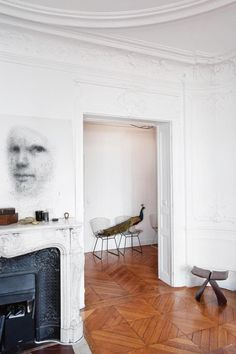 """Living here keeps life simple, and if the duo's interior style has a single keyword, it's 'simplicity'. """"The original aspect of the apartment was already pretty important, with stucco and the large fireplace, so the goal was to maintain a low profile,"""" Sauzay explains."""