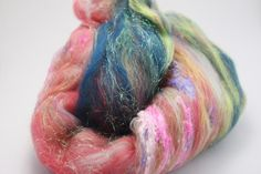 """Fiber Art Batt - Superfine Merino Hand Dyed Mulberry Silk Noils Angelina Sparkle - """"Desert Dancer"""" Spinning Felting Feathertail Fiber Arts is dedicated to helping you as a fiber artist to find the perfect thing for your next project. Whether you enjoy knitting crochet spinning or weaving we want you to know you have a source for quality fiber US sourced fiber add ins and accesories!"""
