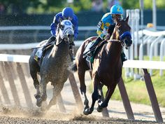 With Frosted at his tail, American Pharoah leads out of the fourth turn in the Belmont Stakes.