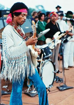 31 Pictures That Show Just How Crazy Woodstock Really Was - Jimi Hendrix on day three of Woodstock
