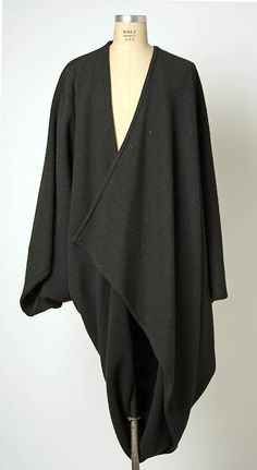 Coat  Issey Miyake  (Japanese, born 1938)    Design House:      Miyake Design Studio (Japanese)  Date:      ca. 1976  Culture:      Japanese  Medium:      wool  Dimensions:      Length at CB: 54 in. (137.2 cm)  Credit Line:      Gift of Alexandra Auchincloss Herzan from the collection of Lily Auchincloss, 1996  Accession Number:      1996.480.20