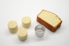 get a small round cutter to make Petit Fours from pound cake... pour an icing over the tops while on a rack..
