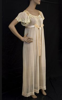 Silk chiffon nightgown, c.1910 The nightgown is fashioned from sheer pink silk chiffon. The bodice, which is pleated to the empire waistline, falls in soft folds below the ribbon ties. The satin ribbon sash is double faced: pink on one side and pale blue on the other side. The neckline is adjustable with a silk ribbon drawstring.