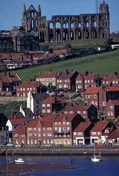 "Whitby Abbey over the town: site of The Synod of Whitby in 664 (establishing Roman practices as the norm over the Celtic & changing the episcopal seat from Lindisfarne to York). In 867 the monastery was destroyed by Viking raiders, & re-founded in 1078. It was in this period that the town gained its current name, Whitby, (from ""white settlement"" in Old Norse)."