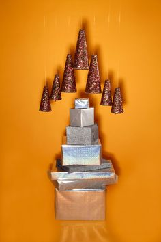 It's Not Too Late To Have A Small-Space Christmas Tree #refinery29  http://www.refinery29.com/small-christmas-trees#slide5  The Swingin' Tree  Feeling DIY ambitious? Go high-style with a mobile/chandelier Christmas tree. Buy a variety of green floral cones and cover them in glue or Mod Podge. Then, roll them in confetti glitter. Attach fishing line with push pins and hang the assembly at your desired level.