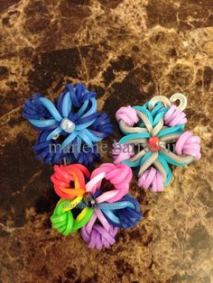 "Created these Flower Charms by using... ""Made By Mommy's Mini Cross Band Charm Tutorial"" --- (Marlene.Barressii)"