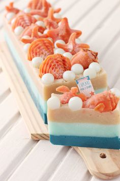 Sea shell embellished hand made soaps. Wonderful colors! Gift idea, too.