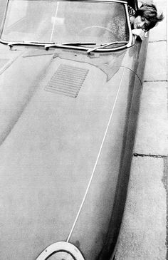 French writer Françoise Sagan in her Jaguar XK-E convertible, photo by Helmut Newton for French Vogue, October 1963.