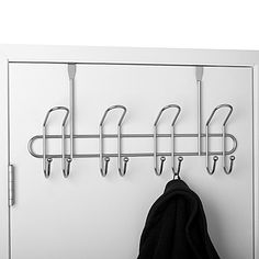 This Heavy Duty Over-the-Door Hook Rack is a convenient addition to your closet or any other door in your home. Holds numerous items from towels to ties for much better organization with 4 heavy duty hooks. Features a satin nickel finish.
