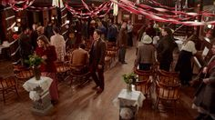 2.03- The saloon decked out for the Dunbar/Graves wedding.  I think it's funny, they treat the saloon more as a community hall, with all the meetings & parties held there.  But I miss the grumpy saloon owner objecting to everyone invading his business!