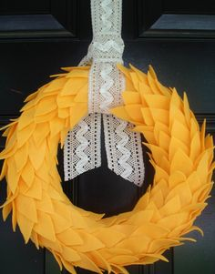 cute wreath. Love the pop of color on the black door. I think I'm leaning for a dark door...