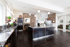 Lovely kitchen with incredible old brick walls. In a converted pub in London.