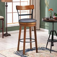 Made of selected rubber wood, this bar stool is durable and sturdy. The four thick flared legs with a built-in foot ring provide strong support and ensure their stability. Featuring 360-degree swivel design, this bar stool gives you the freedom of flexible movement, so you can communicate with others in any direction. Besides, PVC cushioned seat is comfortable to sit. You can put your legs on the footrest and enjoy leisure time.