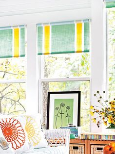 Don't settle for plain roller shades -- with a little paint, you can create custom window treatments that perfectly coordinate with your decor. To make these shades, we taped off stripes and applied latex paint with a foam roller. Be sure to remove the tape immediately; let dry before hanging your custom creations.