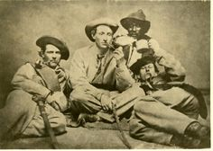 Photograph of members of the 57th Georgia Regiment Officers of Company H (Independent Volunteers) of the 57th Georgia Regiment, Army of Tennessee, 1863. Left to right, First Lieutenant Archibald C. McKinley, Captain John Richard Bonner, Scott (cook), and Second Lieutenant Williams S. Stetson.