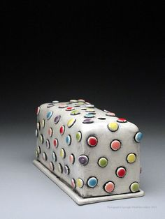 """Flower Brick by Charity Hofert at MudFire Gallery. Handbuilt flower brick made from earthenware clay and decorated with multi-colored underglazes and food-safe glazes. 2.75"""" x 5.5"""" x 2.5"""""""