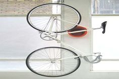 Small Space Bike Storage Solutions (from Apartment Therapy): Cycloc Bicycle Storage from YLiving Bike Hooks, Bike Hanger, Bicycle Rack, Bicycle Stand, Bicycle Wheel, Bike Stands, Wall Hanger, Bicycle Helmet, Bike Storage Small Space