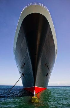 stands on bulbous bow of queen marry