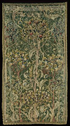 """Portière made from Morris & Co. Oak damask (one of four)  William Morris, 1892–93  259,1 x 137,2 cm (102 x 54 in.) (including fringe).  This portiere, a heavy doorway curtain, is one of a set of four designed and embroidered in the early 1890s by May Morris, William Morris's daughter and head of Morris & Co.'s embroidery department. Its design, known as """"The Orchard"""" or """"A Fruit Garden,"""" was one of Morris's most popular.   Silk damask, embroidered with silk, with silk fringe and cotton…"""