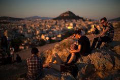 young Greeks on Arios Pagos hill overlooking the city