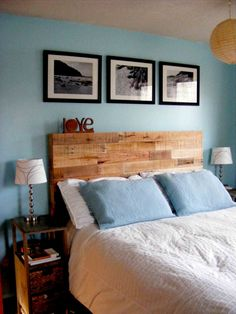 Simple trio above a cool, reclaimed headboard by ThePalletShop.