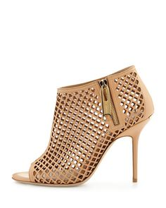 We lust after these Burberry Laser-Cut Leather Camel Booties. Now available at Neiman Marcus Bal Harbour. For everything luxury fashion, make your way over to http://balharbourshops.com/