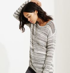 You'll love the feel of this slinky knit sweater—it's designed to move with you. Boatneck. Long sleeves. Drop shoulders.
