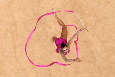 News Photo: Daria Dmitrieva of Russia competes with the ribbon…