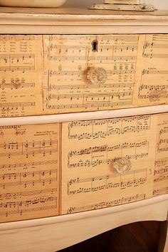 """Redecorate a dresser front with old sheet music. """"Antique"""" the sheet music with strong tea. Just paint it on."""