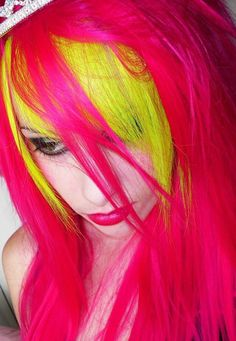 I have always loved this girl's vibrant hair -- http://lovelydyedlocks.tumblr.com/post/18042984179/dazygraves-bright-pink-and-yellow-hair-via