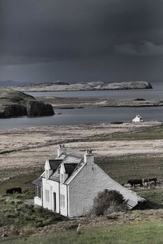 Isle of Skye, Scotland --- A cottage by the shore on an iso. Isle of Skye, Scotland --- A cottage by the shore on an isolated island off the coast of Scotla Places To Travel, Places To See, Cottages By The Sea, Cottages Uk, Scottish Cottages, England And Scotland, Scotland Travel, Highlands Scotland, Barra Scotland