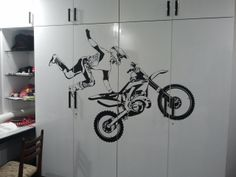 Amazing Motocross Jump wall sticker gives a special effect placed on the doors of this cupboard.