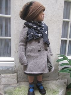 Slouchy hipster hat: check. Scarf worn just so: check.  Gorgeous chunky knit jacket: check, check, check.  She's got it all together.