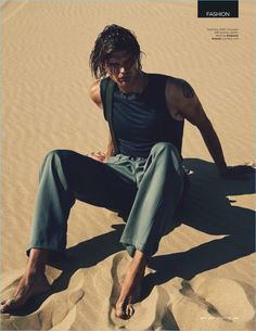 Nick Leary photographs Jesse Gwin in a tank, trousers, and suspenders by Emporio Armani.