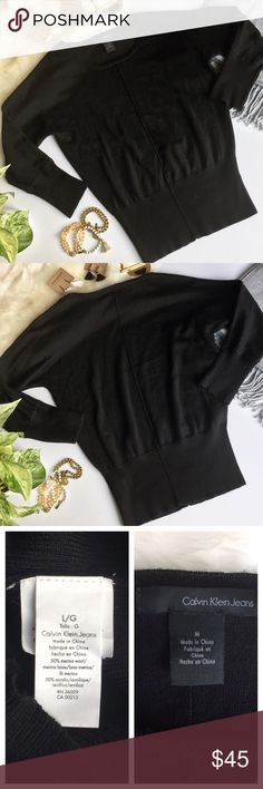 - CALVIN KLEIN - Merino Wool Slouchy Sweater Simple & chic this sweater is an effortless essential for any closet.  Wear on the weekends with ripped jeans and booties or dress up for work with a pencil skirt and statement necklace! ***please note this is