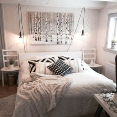 White bedroom with touch of black via http://instagram.com/designbymirelle#