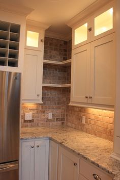 Love the color combos! open shelving between the cabinets and lighting behind the glass