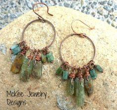 Emerald stone, Kyanite raw gemstone sticks and copper hoop earrings.