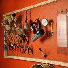 The chicken wire is cool... Don't know if I would like it better than pegboard, but this is a guy's crafting space...