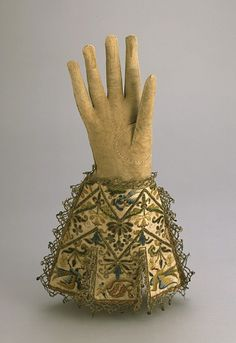 Pair of Man's Gauntlets England, circa 1625-1650 Costumes; Accessories Leather, silk and gold metallic thread, silk satin; looped bullion em...