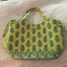"Small Vera Bradley purse Very cute! Very gently used, Small fabric bag (11""X7""). Fabric handles add approx. 4"" of height. Predominantly light green & blue colors with darling elephant pattern along bottom of bag. 2 inside pockets, & reinforced bottom. Vera Bradley Accessories"