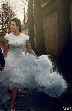 Kim Kardashian in Vogue  Sarah Burton for Alexander McQueen wedding dress, the article says each feather is hand sewn and the dress is light, it looks amazing