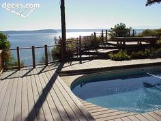 Multilevel deck designs are ideal for an inset spa included on the lowest tier. Above Ground Pool Decks, In Ground Pools, Outside Living, Outdoor Living, Deck Pictures, Backyard Water Feature, Deck Builders, Tropical Garden, Picture Design