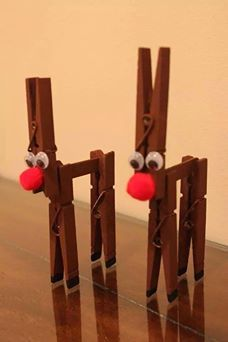 Reindeers made using clothes pegs and lollipop sticks.