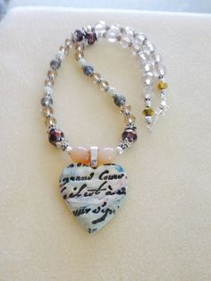 Recycled beads from an old bracelet with polymer pendant